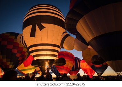 Hot air balloons lit up in the night sky in Albuquerque, New Mexico.