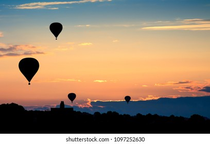 Hot air balloons on sunset. Beautiful nature sky background.