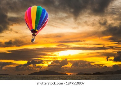 Hot air balloons over the ocean at sunset with dramatic sky. Honolulu Hawaii