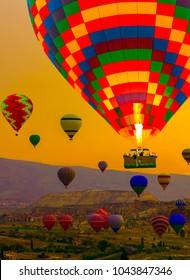 Hot air balloons, rock landscape at Cappadocia Turkey