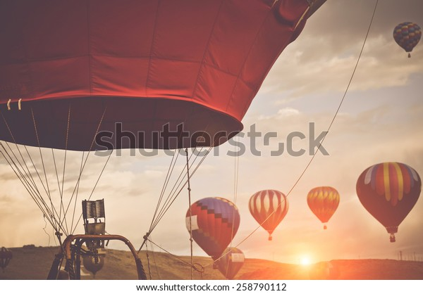 Hot Air Balloons with Sunrise applying Retro Instagram Style Filter