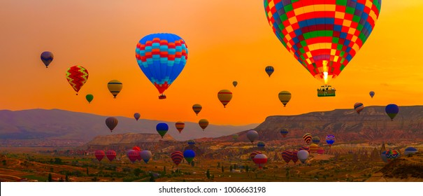 Hot air balloons sunrise landing in a mountain, landscape at Cappadocia Turkey
