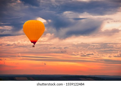Hot Air Baloon Flying with Beautiful Colorful Dramatic Sky at Sunset