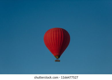 Hot air red balloon in blue sky, Luxor, Egypt