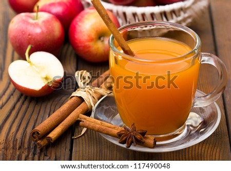 Hot apple cider with cinnamon sticks