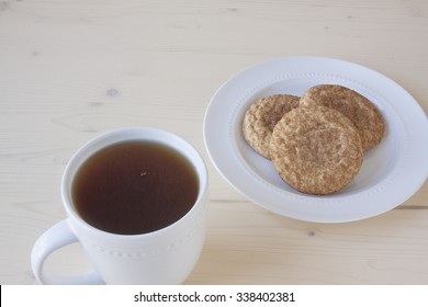Hot Apple Cider and Snickerdoodle Cookies on a White Wooden Background