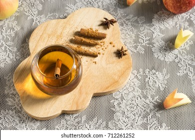 hot apple juice in glass with cinnamon. autumn food concept