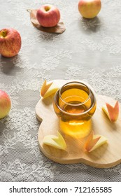 hot apple juice in glass on white fabric and apple slice. autumn food concept