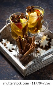 hot apple tea with spices and gingerbread cookies, vertical, closeup