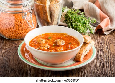 Hot aromatic rich tomato soup with meatballs, vegetables, red lentils, thyme, tasty homemade first course, food, dinner