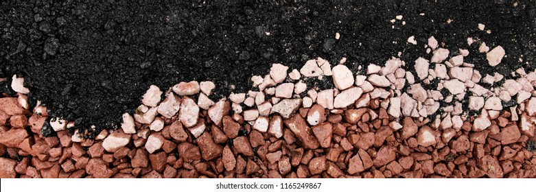 hot asphalt drying on base course with gravel and stones, panorama
