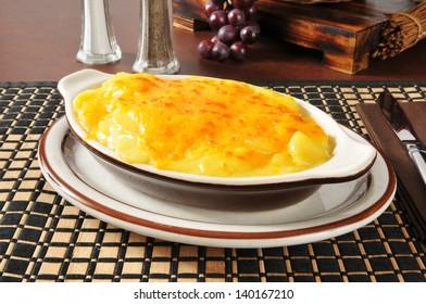 Hot au gratin potatoes in a casserole dish