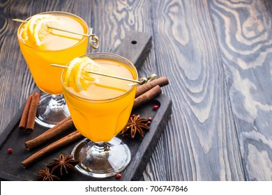 hot autumn drink cider from apples with lemon, cinnamon, sea buckthorn and anise stars