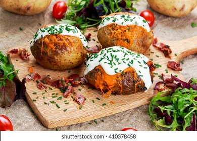Hot Baked Potato with cheese, bacon, chives and sour cream.