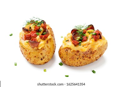 Hot baked potato topped with bacon, green onions and sun dried tomatoes. isolated on white background