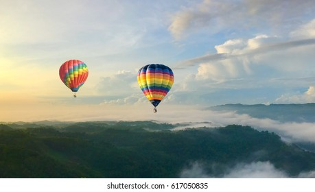 hot balloon fly over the cloud during sunrise at bagunan tropical gunung kidul yogjakarta