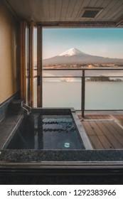 hot bath Japanese onsen in Traditional ryokan resort with beautiful Mt.Fuji view background at Kawaguchiko lake, Yamanashi, Japan