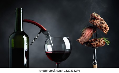 Hot beef steak with rosemary and red wine.