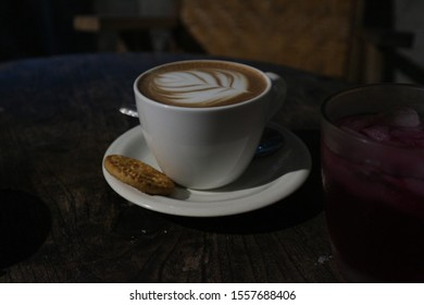 hot beverage, cafelatte with biscuit from local cafe