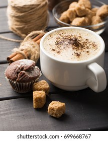 hot black coffee with cookies and beans in cafe