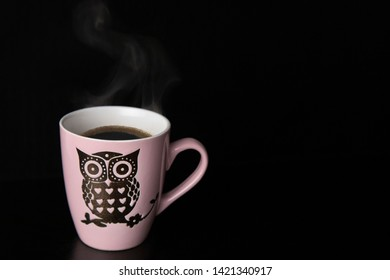 Hot black coffee cup with sweet owl symbol