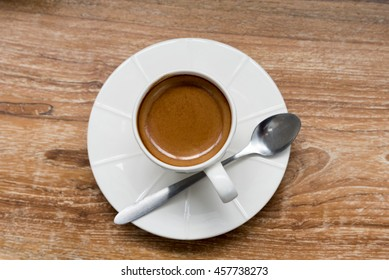 Hot black coffee on table