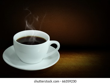 Hot black coffee on the table wood