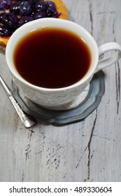 Hot black tea in a white cup