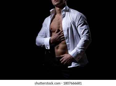 Hot boy. Sexy torso of a muscular man. Sensual handsome muscular gay with open shirt and hot body