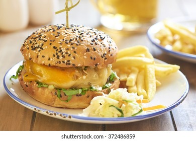 Hot burger with cheese, lettuce and jalapeno