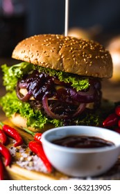 Hot burgers on wooden table, fresh traditional food