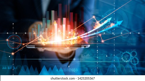 Hot business growth. Businessman using tablet analyzing sales data and economic growth graph chart. Business strategy, financial and banking. Digital marketing.