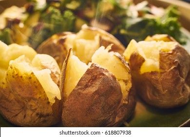 Hot buttered jacket baked potatoes close up with steam