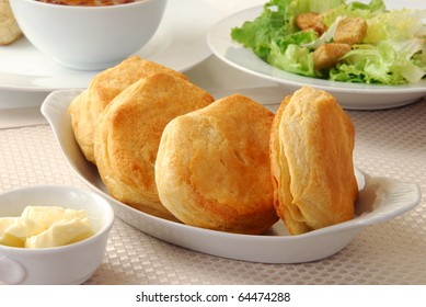 Hot buttermilk biscuits on with salad and butter