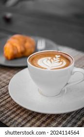 hot cafelatte with plain croisant
