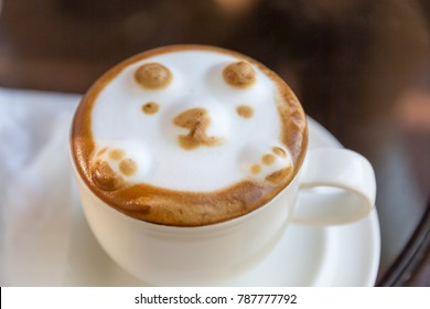 Hot cappuccino coffee with latte arts bear face