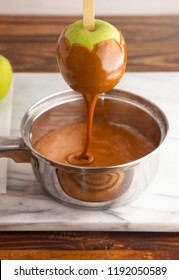 Hot Caramel Flowing of a Hand Dipped Homemade Caramel Apples