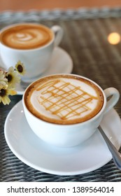 hot caramel macchiato coffee drink put on table in cafe