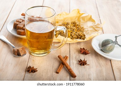 Hot chamomile tea made of wild flowers with a mesh ball tea infuser