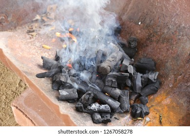 hot charcoal with smoke