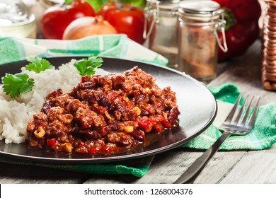 Hot chili con carne with ground beef, beans, tomatoes and corn served with rice. Mexican cuisine