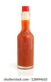 Hot chili pepper sauce in glass bottle on a white background