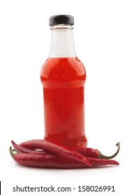 Hot chili pepper sauce on a white