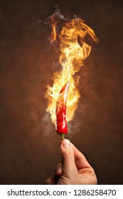 Hot chili pepper surrounded by fire and flames