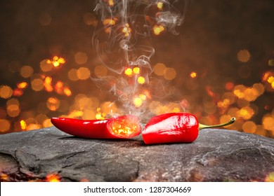 Hot chili pepper surrounded by embers and smoke