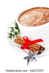 Hot Chocolate, christmas ball,  cinnamon sticks and tree branch isolated on white, closeup.  Bright Christmas composition
