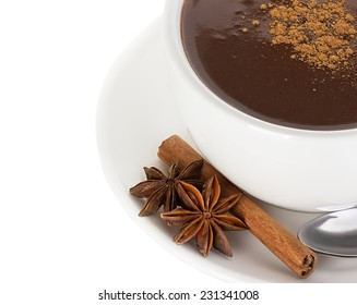 Hot chocolate with cinnamon and anise isolated on white background