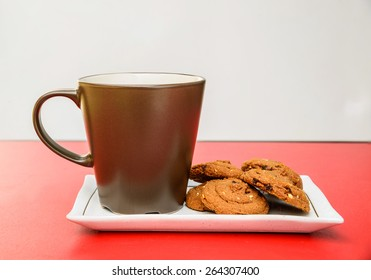 Hot chocolate and cookies isolated on red background