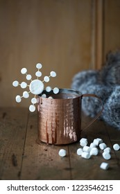 Hot chocolate in a copper mug with marshmallows