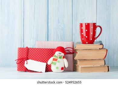 Hot chocolate cup and christmas gift boxes. View with copy space
